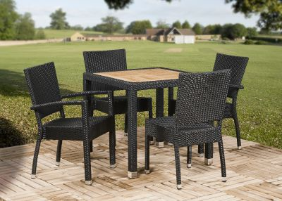 Outdoor Weave Dining Set With Four Chairs And A Teak Table