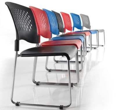 Row Of Dotty Stackable Furniture In Different Colours With Chrome Skid Base