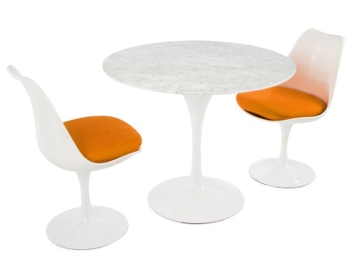 Tuilp Dining Set With Two Chairs And A Round Table With A Marble Top And Orange Cushions