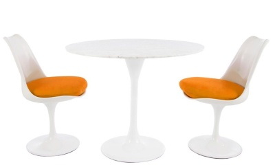 Tulip Dining Set With Two Chairs With Orange Cushions And A Table With A Marble Top