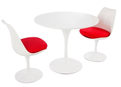Tulip Dining Chairs With Two Chairs Wit A Red Seat Cushion And A Round Table With A White Top