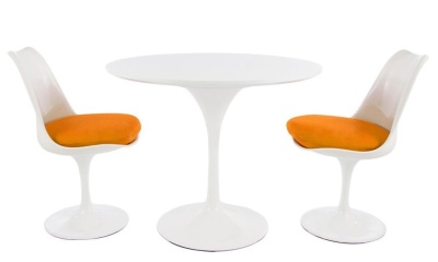 Tulip Dining Hseta With Two Tulip Chairs With Orange Seats And A Round Table With A High Ngloss White Top